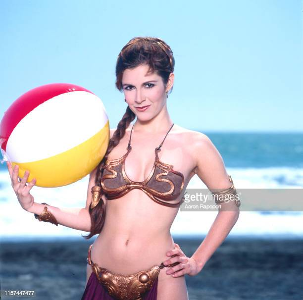 Actress Carrie Fisher poses on the beach for Star Wars in October 1983.